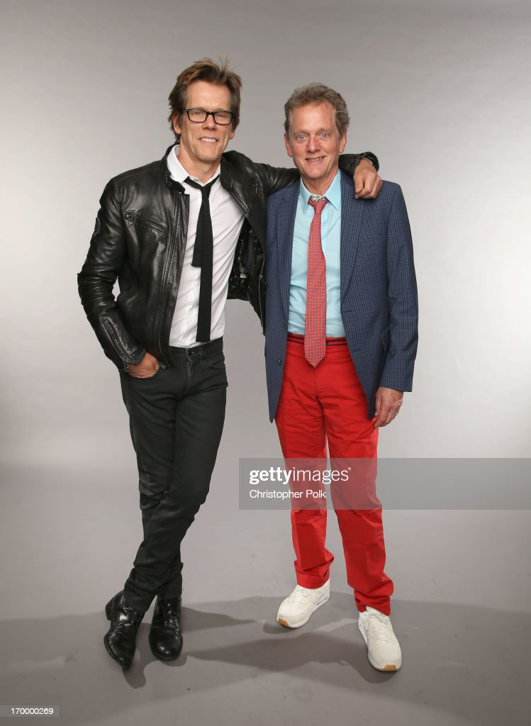 Kevin Bacon and Michael Bacon of the Bacon Brothers pose at the Wonderwall portrait studio during the 2013 CMT Music Awards at Bridgestone Arena on June 5, 2013 in Nashville, Tennessee.