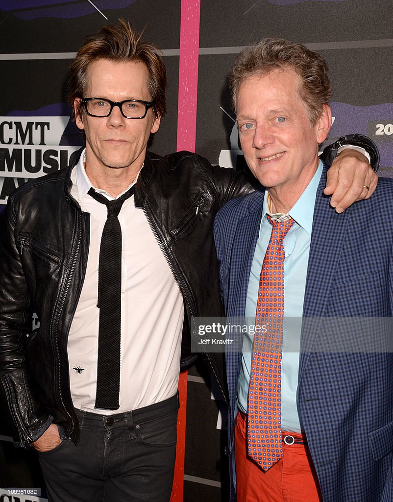 <a gi-track='captionPersonalityLinkClicked' href=/galleries/search?phrase=Kevin+Bacon&family=editorial&specificpeople=202000 ng-click='$event.stopPropagation()'>Kevin Bacon</a> and <a gi-track='captionPersonalityLinkClicked' href=/galleries/search?phrase=Michael+Bacon&family=editorial&specificpeople=233753 ng-click='$event.stopPropagation()'>Michael Bacon</a> of the band The Bacon Brothers arrive at the 2013 CMT Music Awards at the Bridgestone Arena on June 5, 2013 in Nashville, Tennessee.