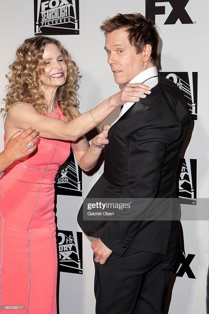 Kevin Bacon attempts to give an 'over the shoulder' pose, but is shut down by wife Kyra Sedgwick, at Fox And FX's 2014 Golden Globe Awards Party - Arrivals on January 12, 2014 in Beverly Hills, California.