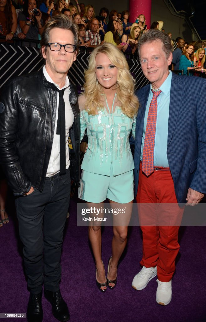 Kevin Bacon, Carrie Underwood and Michael Bacon attend the 2013 CMT Music awards at the Bridgestone Arena on June 5, 2013 in Nashville, Tennessee.
