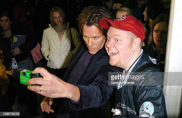 Kevin Bacon director with fan during 2005 Sundance Film Festival 'Loverboy' Premiere at Eccles Theatre in Park City Utah United States