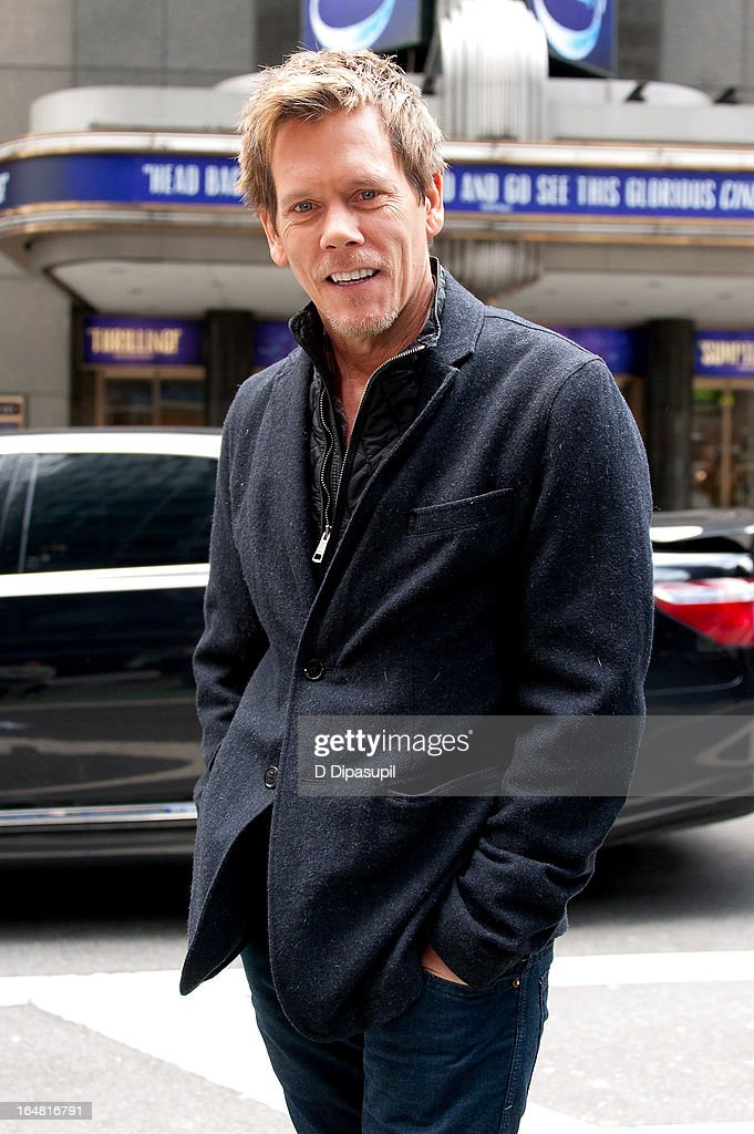 <a gi-track='captionPersonalityLinkClicked' href=/galleries/search?phrase=Kevin+Bacon&family=editorial&specificpeople=202000 ng-click='$event.stopPropagation()'>Kevin Bacon</a> visits 'Extra' in Times Square on March 28, 2013 in New York City.