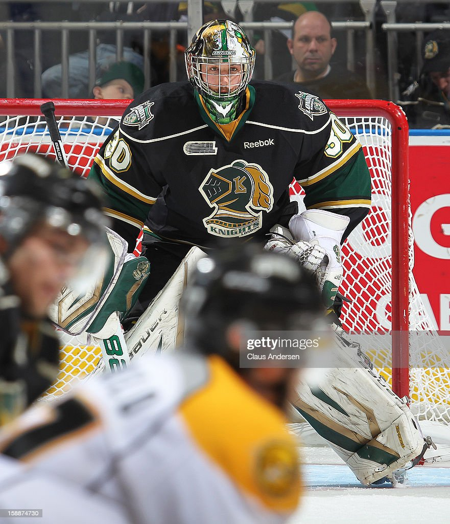 Kevin Bailie #30 of the London Knights waits to face a shot in an OHL game against the Sarnia Sting on January 1, 2013 at the Budweiser Gardens in London, Canada. The Sting defeated the Knights 6-5 in overtime to snap London's 24 game winning streak.