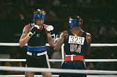 Kevin Barry of New Zealand and Evander Holyfield of the USA competing in the semifinal of the Light Heavyweight boxing event at the Los Angeles...