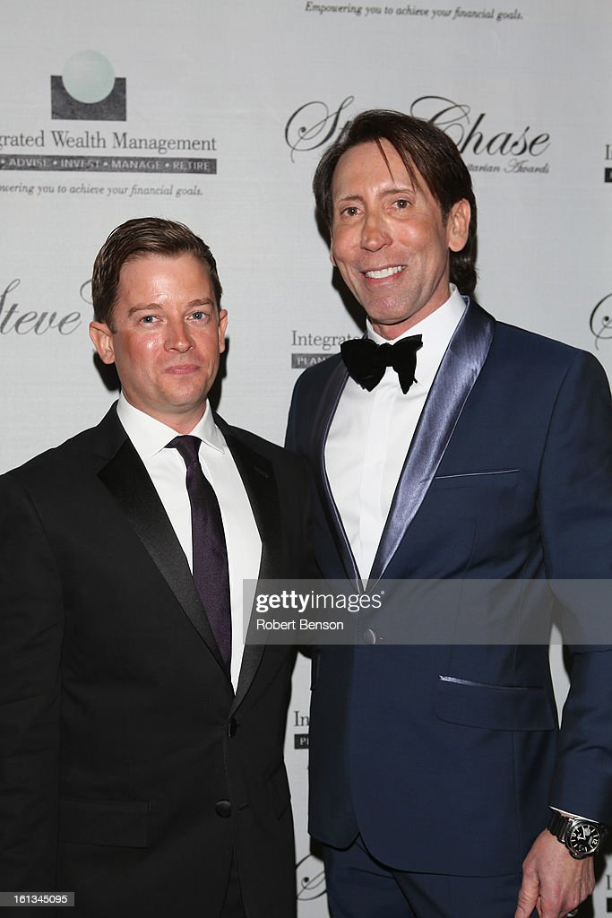 Kevin Bass (R) with guest arrives at the 19th Annual Steve Chase Humanitarian Awards Gala at the Palm Springs Convention Center on February 9, 2013 in Palm Springs, California.