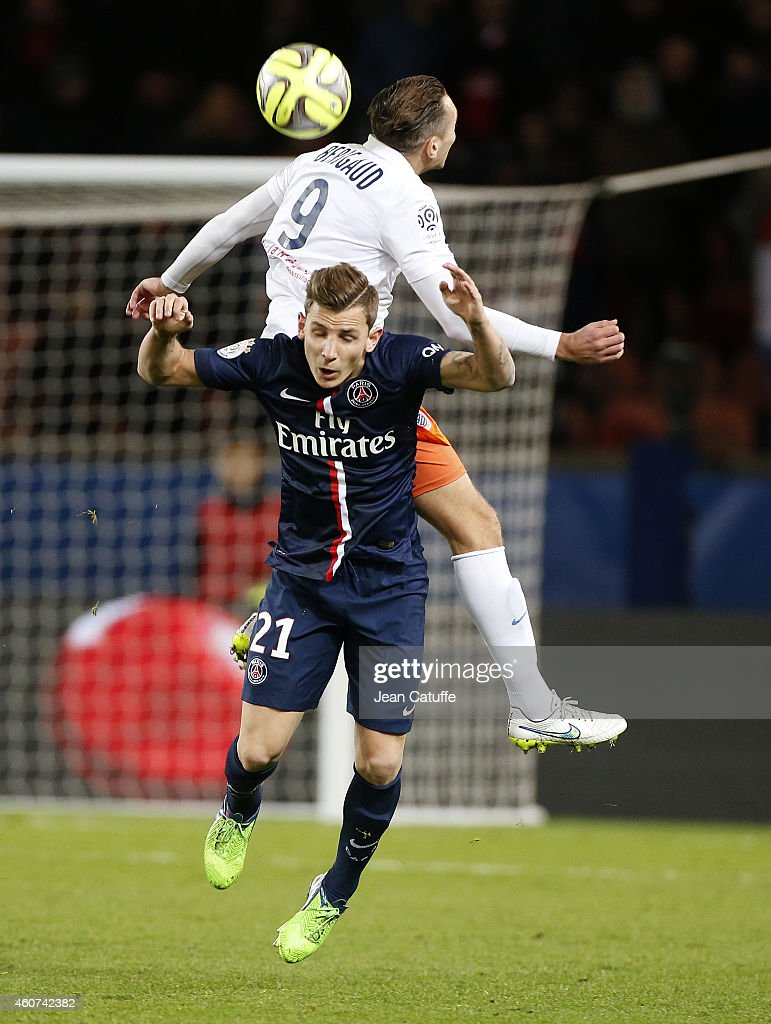 Kevin Berigaud of Montpellier (top) and <a gi-track='captionPersonalityLinkClicked' href=/galleries/search?phrase=Lucas+Digne&family=editorial&specificpeople=5805298 ng-click='$event.stopPropagation()'>Lucas Digne</a> of PSG in action during the French Ligue 1 match between Paris Saint-Germain FC and Montpellier Herault SC at Parc des Princes stadium on December 20, 2014 in Paris, France.
