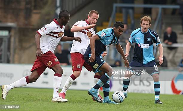 Kevin Betsy of Wycombe Wanderers looks to move away from Josh Walker and Abdul Osman of Northampton Town as team mate Stuart lewis looks onduring the...