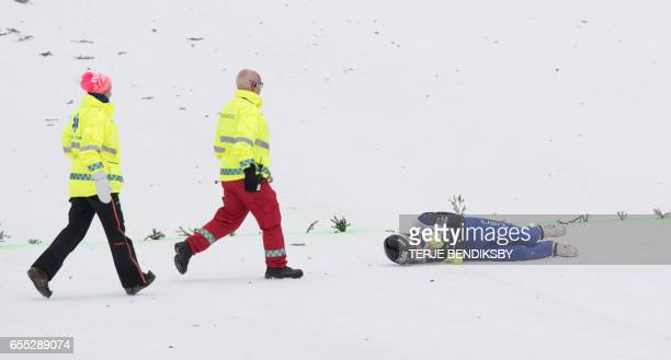 Kevin Bickner from USA is approached by paramedics after falling in the second round of FIS Ski Jumping World Cup Men´s HS225 in Vikersund on March...