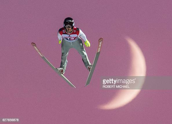 Kevin Bickner of USA competes in front of the moon during the FIS Ski Jumping World Cup on December 4 2016 in Klingenthal eastern Germany Domen Prevc...