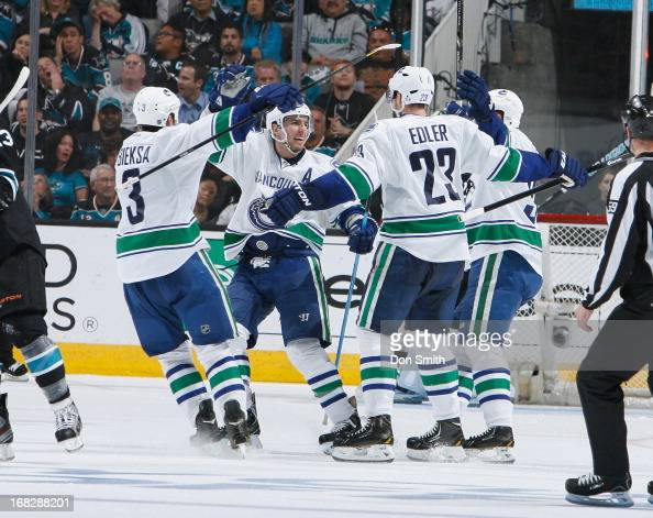 Kevin Bieksa Alexander Edler and Alexandre Burrows of the Vancouver Canucks celebrate a goal against the San Jose Sharks in Game Four of the Western...
