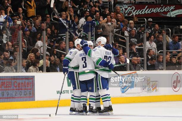Kevin Bieksa and Alexander Edler of the Vancouver Canucks celebrate with teammates after a goal against the Los Angeles Kings in Game Three of the...