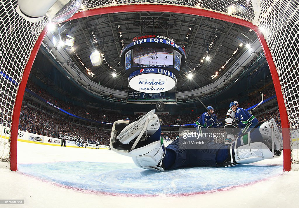 <a gi-track='captionPersonalityLinkClicked' href=/galleries/search?phrase=Kevin+Bieksa&family=editorial&specificpeople=688792 ng-click='$event.stopPropagation()'>Kevin Bieksa</a> #3 and <a gi-track='captionPersonalityLinkClicked' href=/galleries/search?phrase=Ryan+Kesler&family=editorial&specificpeople=206915 ng-click='$event.stopPropagation()'>Ryan Kesler</a> #17 of the Vancouver Canucks look back as <a gi-track='captionPersonalityLinkClicked' href=/galleries/search?phrase=Raffi+Torres&family=editorial&specificpeople=204612 ng-click='$event.stopPropagation()'>Raffi Torres</a> #13 of the San Jose Sharks scores in overtime on goalie <a gi-track='captionPersonalityLinkClicked' href=/galleries/search?phrase=Roberto+Luongo&family=editorial&specificpeople=202638 ng-click='$event.stopPropagation()'>Roberto Luongo</a> #1 of the Vancouver Canucks during Game Two of the Western Conference Quarterfinals during the 2013 NHL Stanley Cup Playoffs at Rogers Arena on May 3, 2013 in Vancouver, British Columbia, Canada. San Jose won 3-2 in overtime.