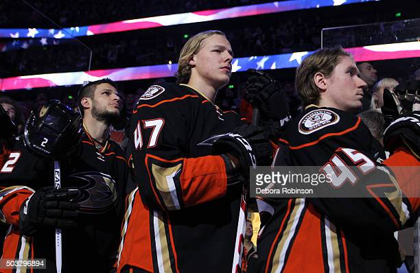 Kevin Bieksa Hampus Lindholm and Sami Vatanen of the Anaheim Ducks stand during the national anthem before the game against the Winnipeg Jets on...