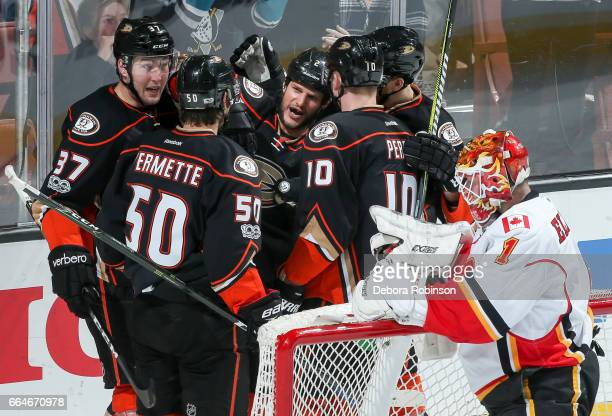 Kevin Bieksa of the Anaheim Ducks center celebrates his secondperiod goal with Nick Ritchie Antoine Vermette Corey Perry and Korbinian Holzer as...