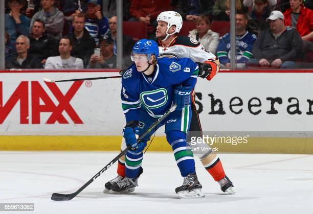 Kevin Bieksa of the Anaheim Ducks checks Brock Boeser of the Vancouver Canucks during their NHL game at Rogers Arena March 28 2017 in Vancouver...