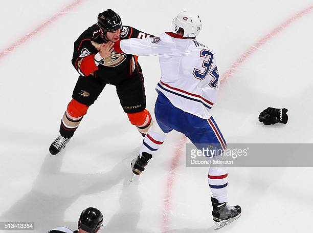 Kevin Bieksa of the Anaheim Ducks fights against Michael McCarron of the Montreal Canadiens on March 2 2016 at Honda Center in Anaheim California