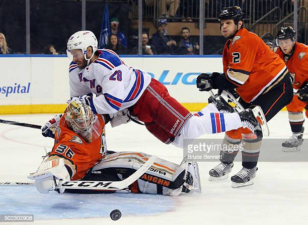 Kevin Bieksa of the Anaheim Ducks is called for crosschecking Dominic Moore of the New York Rangers into John Gibson during the second period at...