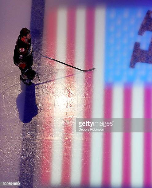 Kevin Bieksa of the Anaheim Ducks stands on the ice during the national anthem before the game against the Philadelphia Flyers on December 27 2015 at...