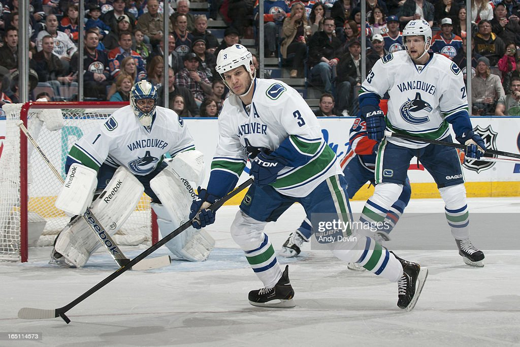 Kevin Bieksa #3 of the Vancouver Canucks skates on the ice in a game against the Edmonton Oilers on March 30, 2013 at Rexall Place in Edmonton, Alberta, Canada.