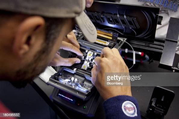Kevin Bistodean a fiber splicer with US Internet Corp places two cables into a fusion splicer during installation in Minneapolis Minnesota US on...