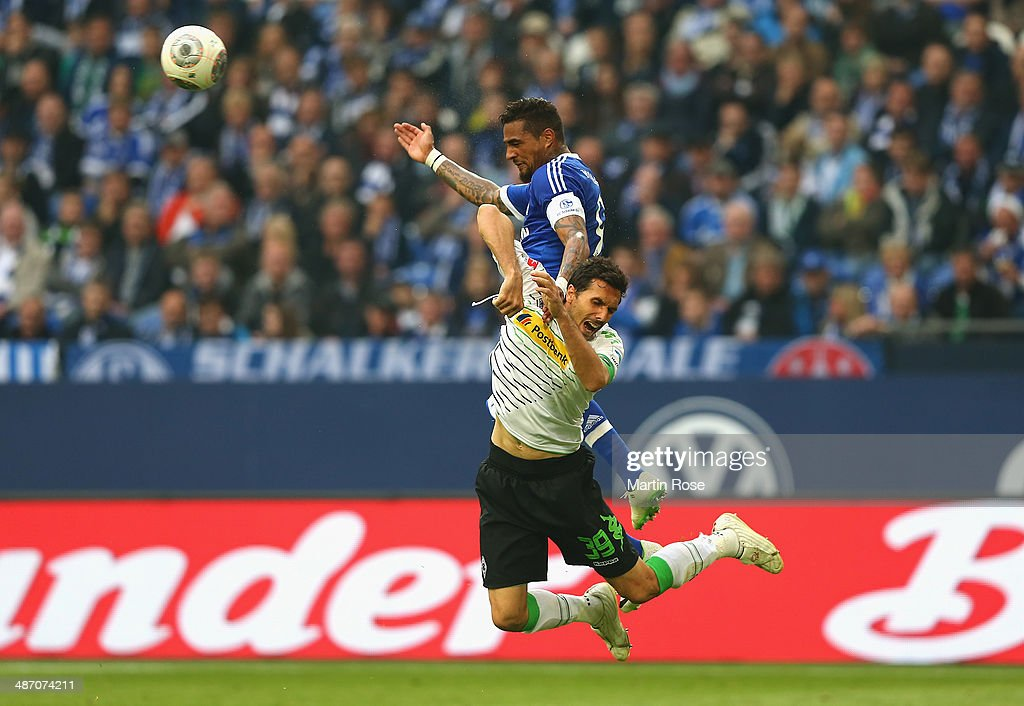Kevin Boateng of Schalke and <a gi-track='captionPersonalityLinkClicked' href=/galleries/search?phrase=Martin+Stranzl&family=editorial&specificpeople=674140 ng-click='$event.stopPropagation()'>Martin Stranzl</a> of Moenchengladbach battle for the ball during the Bundesliga match between FC Schalke 04 and Borussia Moenchengladbach at Veltins-Arena on April 27, 2014 in Gelsenkirchen, Germany.