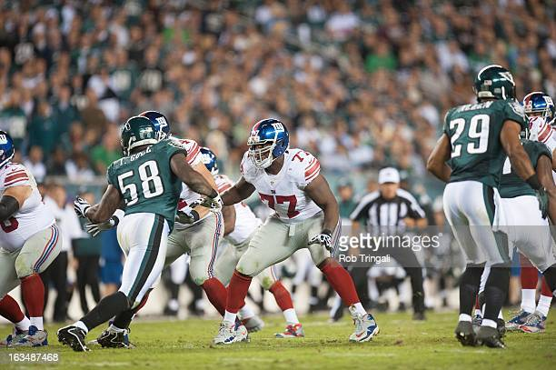 Kevin Boothe of the New York Giants defends his position against Trent Cole of the Philadelphia Eagles during the game between the two teams at...