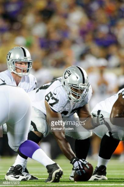 Kevin Boothe of the Oakland Raiders prepares to snap the ball during the game against the Minnesota Vikings on August 8 2014 at TCF Bank Stadium in...