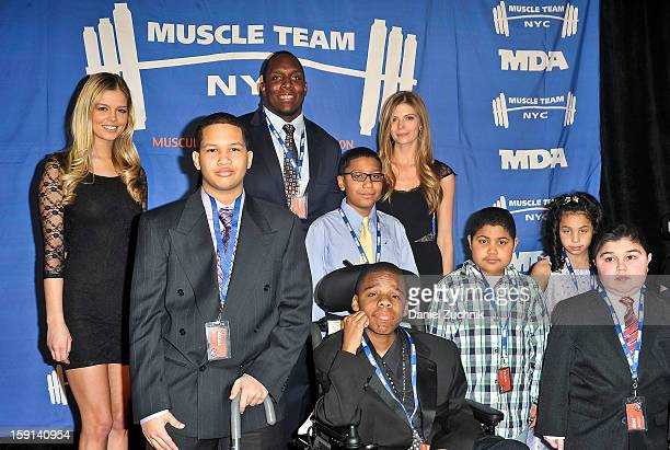 Kevin Boothe with children attend the 16th Annual MDA Muscle Team Gala and Benefit Auction at Pier 60 on January 8 2013 in New York City