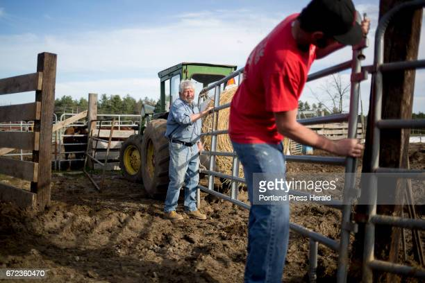 Kevin Brown at right helps Arthur Randall Jr at left secure a gate so they can steer the bulls into a different pen Brown has been occasionally...