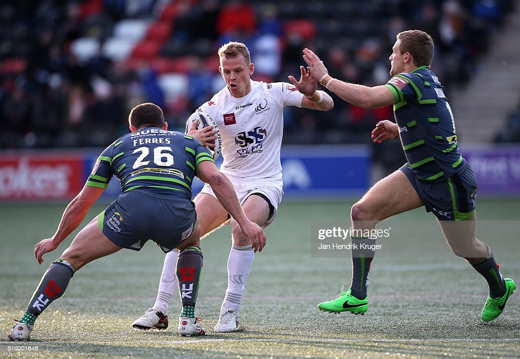 <a gi-track='captionPersonalityLinkClicked' href=/galleries/search?phrase=Kevin+Brown+-+Rugby+Player&family=editorial&specificpeople=11919095 ng-click='$event.stopPropagation()'>Kevin Brown</a> of Widnes Vikings is tackled by Jimmy Keinhorst of Leeds Rhinos during the First Utility Super League match between Widnes Vikings and Leeds Rhinos at Select Security Stadium on February 14, 2016 in Widnes, England.