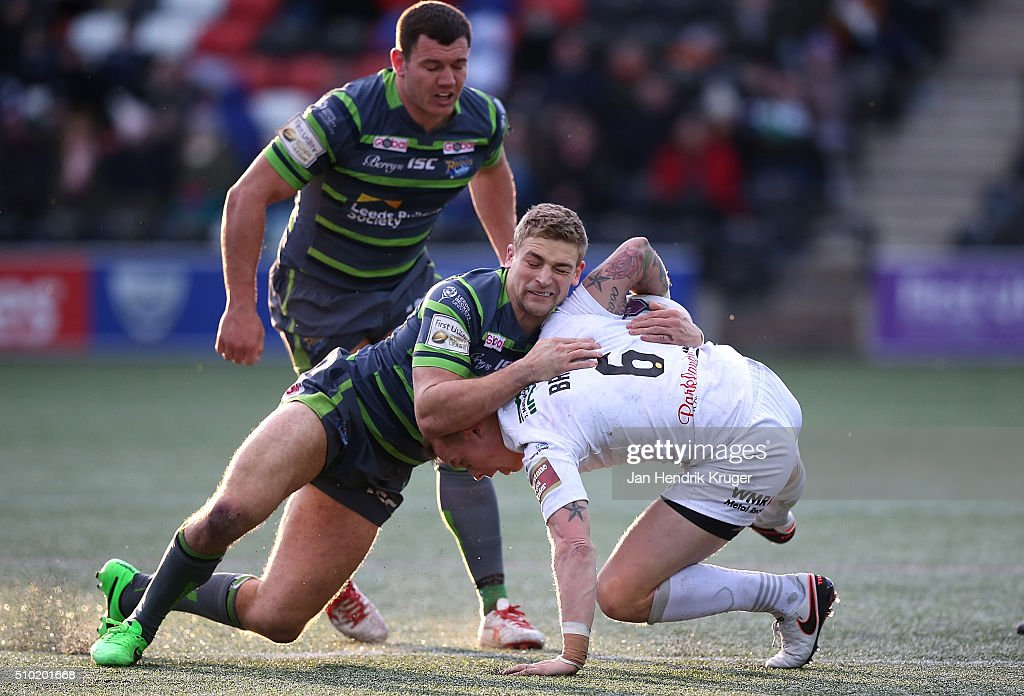 <a gi-track='captionPersonalityLinkClicked' href=/galleries/search?phrase=Kevin+Brown+-+Rugbyspieler&family=editorial&specificpeople=11919095 ng-click='$event.stopPropagation()'>Kevin Brown</a> of Widnes Vikings is tackled by Jimmy Keinhorst of Leeds Rhinos during the First Utility Super League match between Widnes Vikings and Leeds Rhinos at Select Security Stadium on February 14, 2016 in Widnes, England.