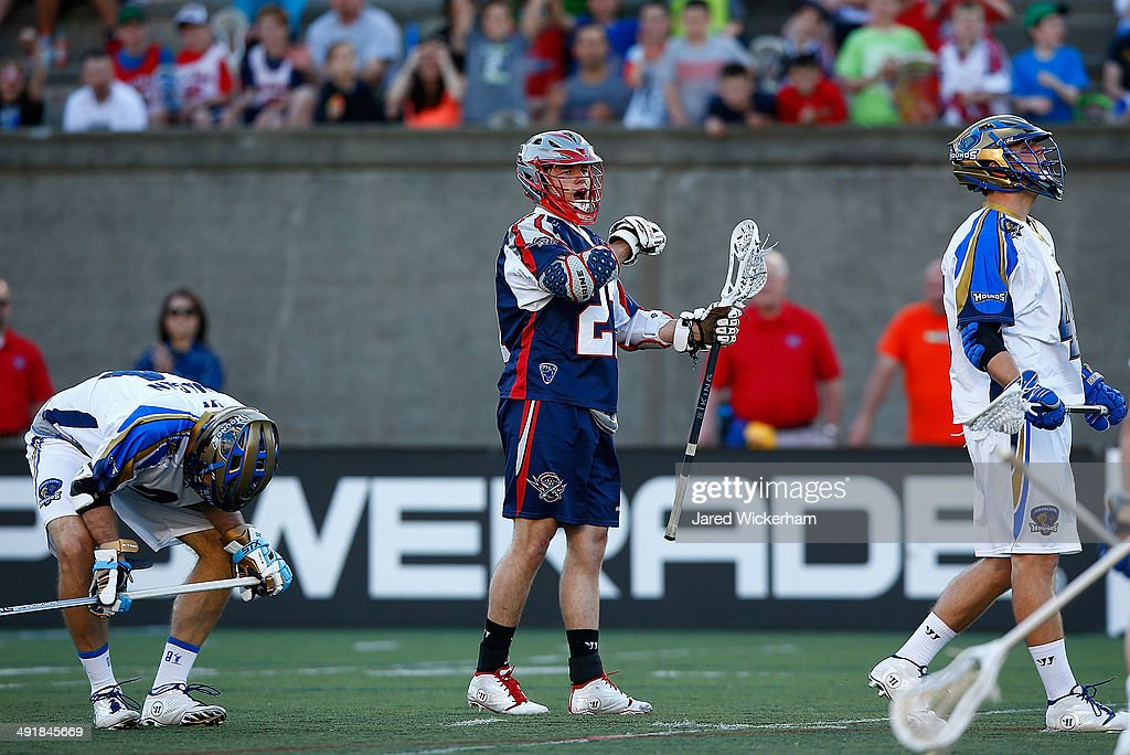 Kevin Buchanan of the Boston Cannons celebrates a goal in the first half against the Charlotte Hounds during the game at Harvard Stadium on May 17...