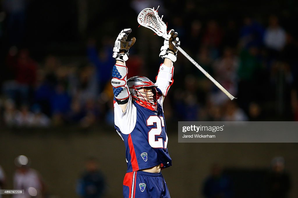 Kevin Buchanan #27 of the Boston Cannons celebrates his game-tying goal in the fourth quarter against the Denver Outlaws at Harvard Stadium on May 10, 2014 in Boston, Massachusetts.