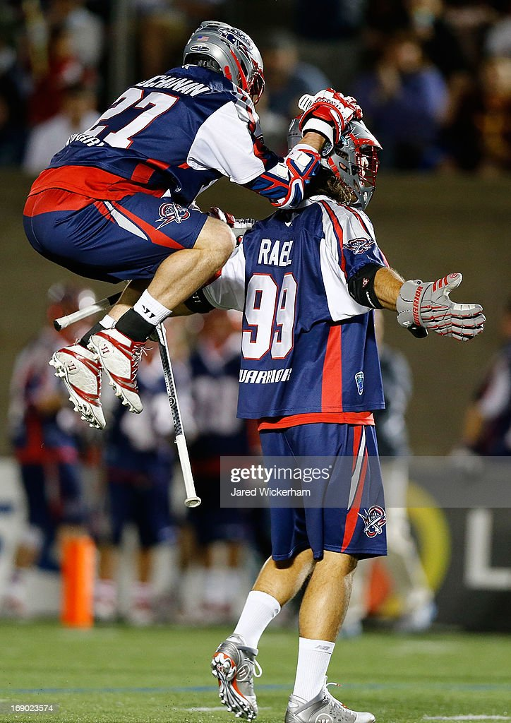 Kevin Buchanan #27 of the Boston Cannons celebrates with teammate <a gi-track='captionPersonalityLinkClicked' href=/galleries/search?phrase=Paul+Rabil&family=editorial&specificpeople=4307127 ng-click='$event.stopPropagation()'>Paul Rabil</a> #99 following a goal in the second half against the Chesapeake Bayhawks during the game on May 18, 2013 at Harvard Stadium in Boston, Massachusetts.