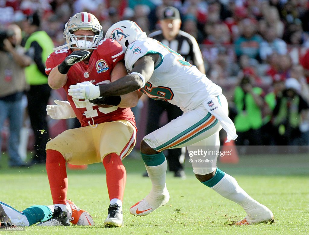 Kevin Burnett of the Miami Dolphins brings down Bruce Mille of the San Francisco 49ers at Candlestick Park in San Francisco, California, on Sunday, December 9, 2012. The San Francisco 49ers defeated the Miami Dolphins, 27-13.