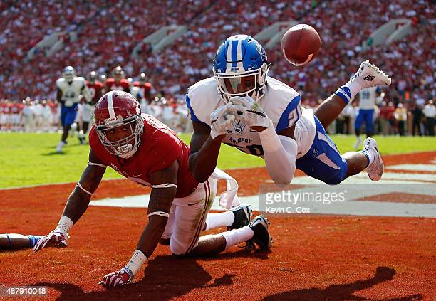 Kevin Byard of the Middle Tennessee Blue Raiders fails to intercept this pass that was broken up while defending against ArDarius Stewart of the...