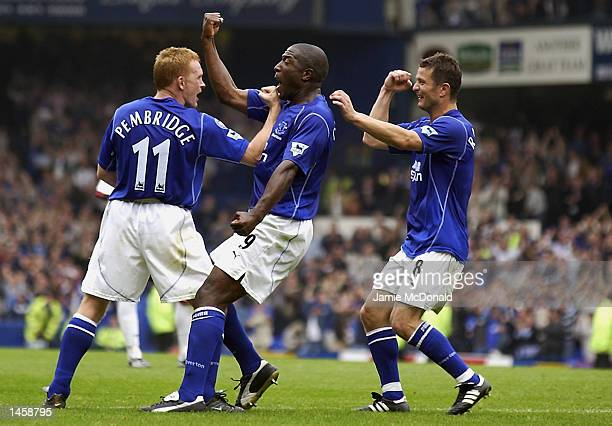 Kevin Campbell of Everton celebrates his goal with teammates Mark Pembridge and Tomasz Radzinski during the FA Barclaycard Premiership match between...