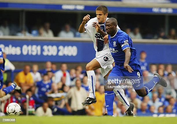 Kevin Campbell of Everton clashes with Alessandro Gamberini of Bologna during the Colin Harvey Testimonial match between Everton and Bologna on at...