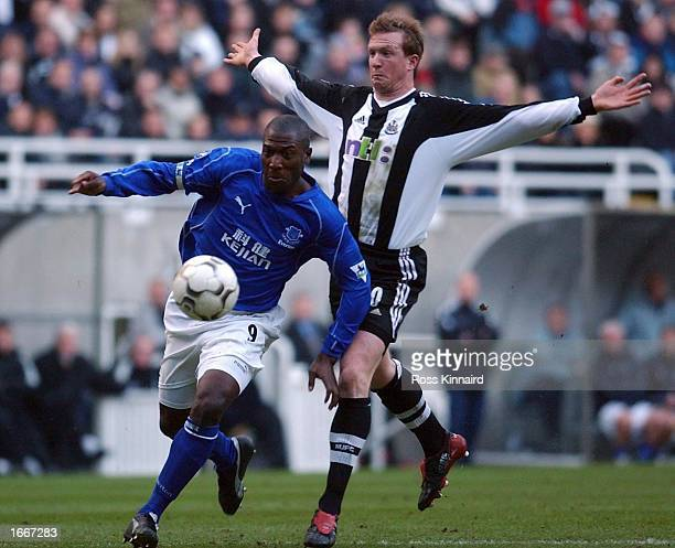 Kevin Campbell of Everton goes past Steven Caldwell of Newcastle on his way to scoring the opening goal during the FA Barclaycard Premiership match...