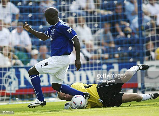 Kevin Campbell of Everton is foiled by Jonathan Gould the goalkeeper of Preston during the Friendly match between Preston North End and Everton on...