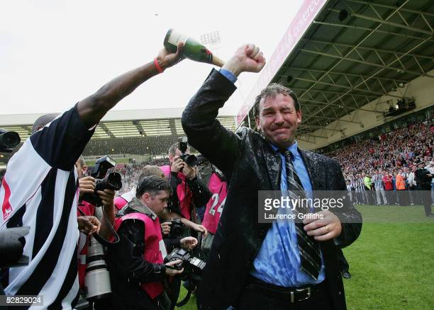 Kevin Campbell pours champagne over Bryan Robson of WBA after securing premiership status at the end of the Barclays Premiership match between West...