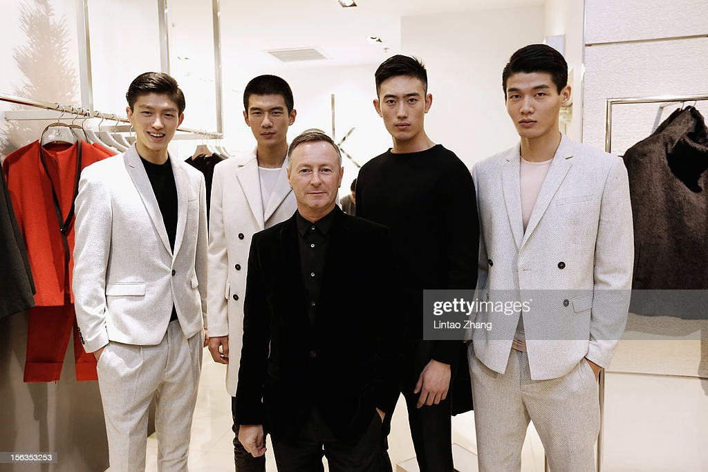 Kevin Carrigan, Global Creative Director, poses for picture with models during the Fall 2012 Presentation at the Calvin Klein store in Oriental Plaza on November 13, 2012 in Beijing, China.