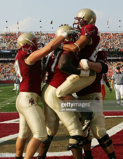 Kevin Challenger of the Boston College Eagles celebrates his touchdown with his teammates against the Clemson Tigers during their Atlantic Coast...