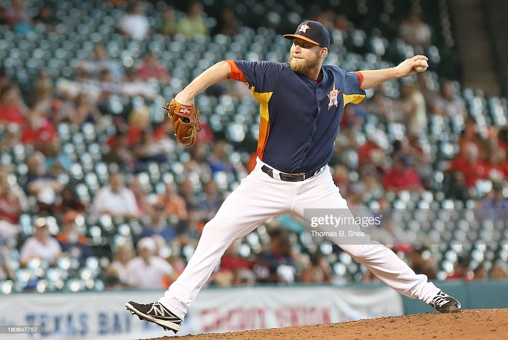 Kevin Chapman #66 of the Houston Astros pitches to <a gi-track='captionPersonalityLinkClicked' href=/galleries/search?phrase=Howie+Kendrick&family=editorial&specificpeople=628938 ng-click='$event.stopPropagation()'>Howie Kendrick</a> #47 of the Los Angeles Angels of Anaheim in the eighth inning on September 15, 2013 at Minute Maid Park in Houston, Texas.