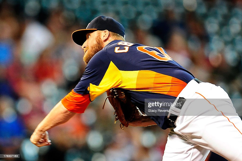 Kevin Chapman #66 of the Houston Astros throws a pitch in the ninth inning during a game against the Toronto Blue Jays at Minute Maid Park on August 25, 2013 in Houston, Texas. Toronto won the game 2-1.
