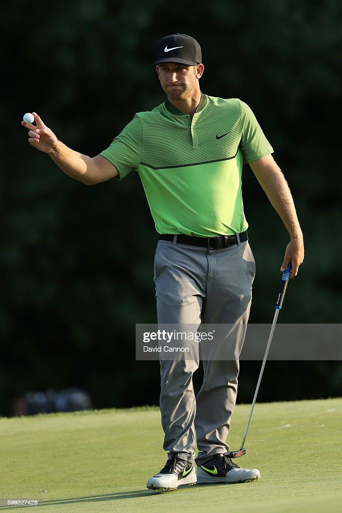 Kevin Chappell acknowledges the crowd on the 18th green during the third round of the Deutsche Bank Championship at TPC Boston on September 4, 2016 in Norton, Massachusetts.