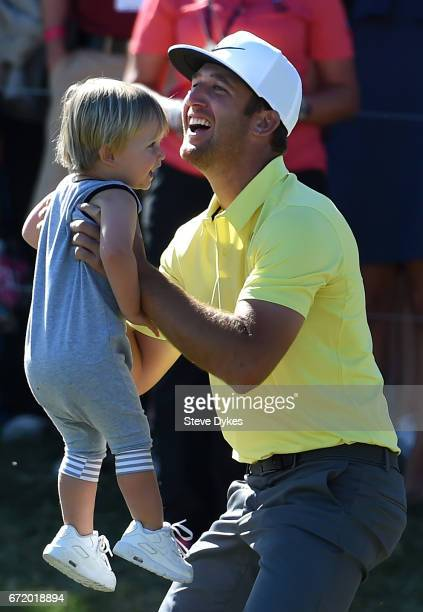 Kevin Chappell celebrates with his son Wyatt after putting in to win on the 18th green during the final round of the Valero Texas Open at TPC San...