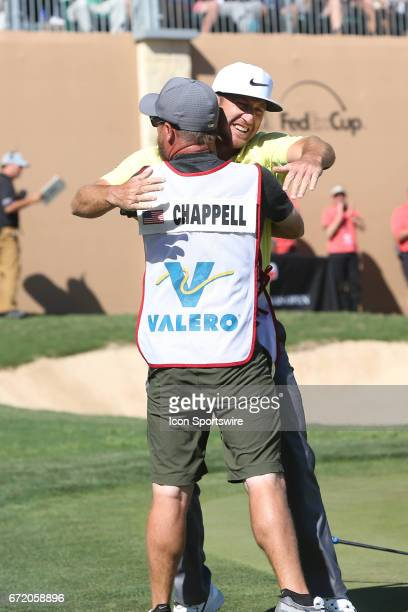 Kevin Chappell hugs his caddie after winning the Valero Texas Open at the TPC San Antonio Oaks Course in San Antonio TX on April 23 2017