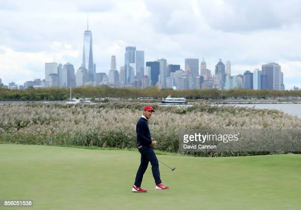 Kevin Chappell of the United States team celebrates holing a birdie putt on the 10th green in his match with Charley Hoffman against Jason Day...