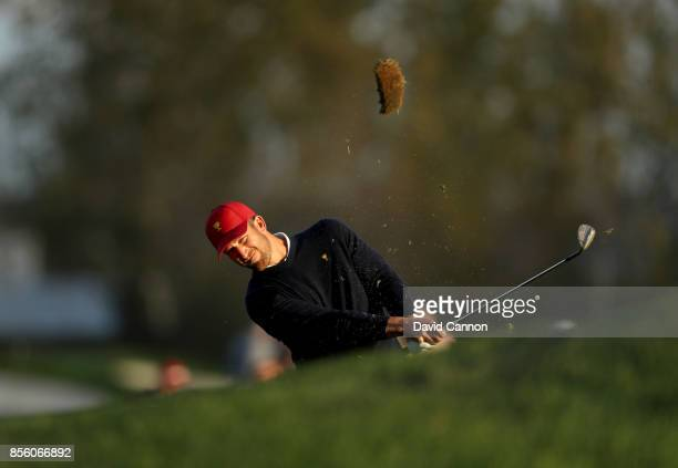 Kevin Chappell of the United States team plays his second shot on the 17th hole in his match with Charley Hoffman against Jason Day Anirban Lahiri...